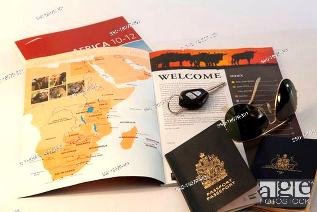 Stock Photo: Map and car key with two passports.