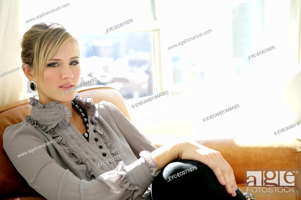Stock Photo: Young woman relaxing indoors.