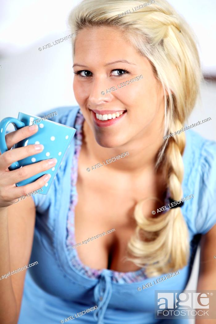 Stock Photo: blond woman drinking a cup of coffee.