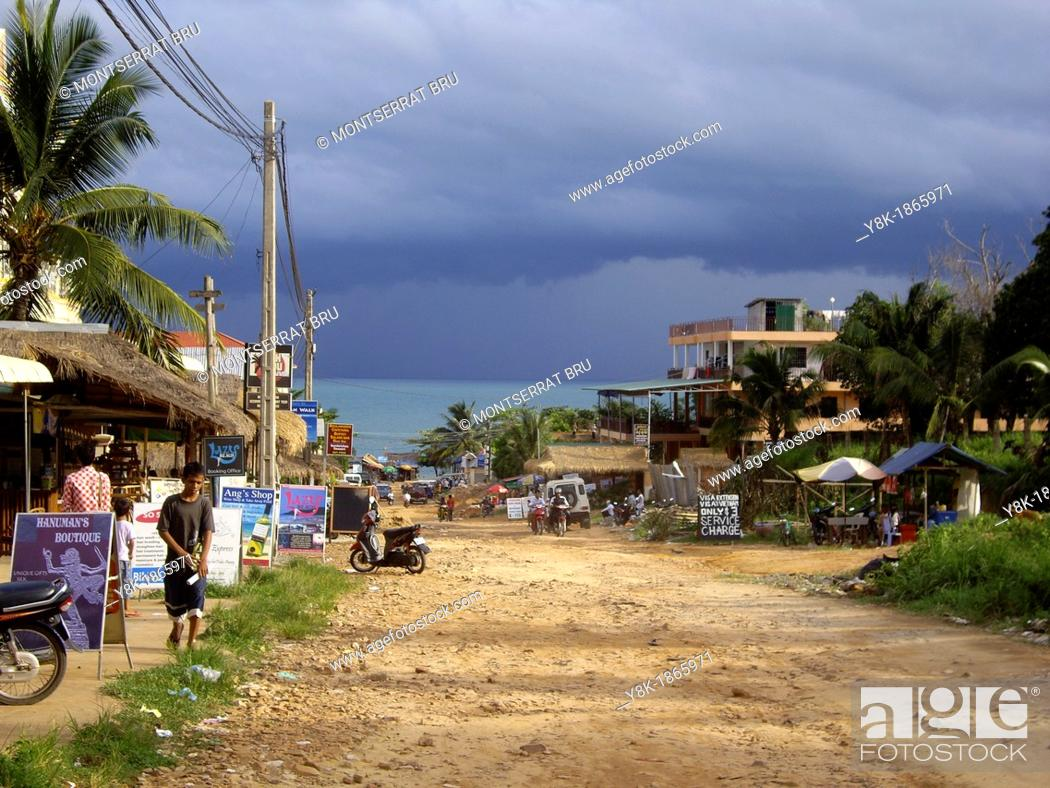 Stock Photo: Serendipity road in Sihanoukville, Cambodia during the monsoon.