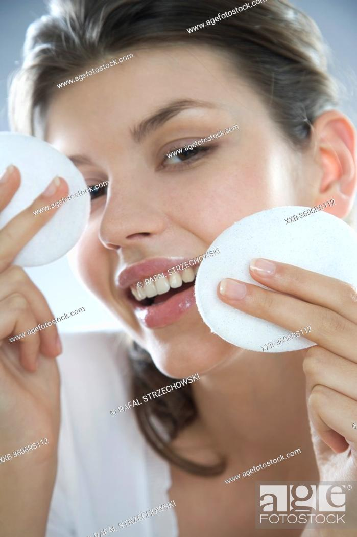 Stock Photo: woman cleaning face.