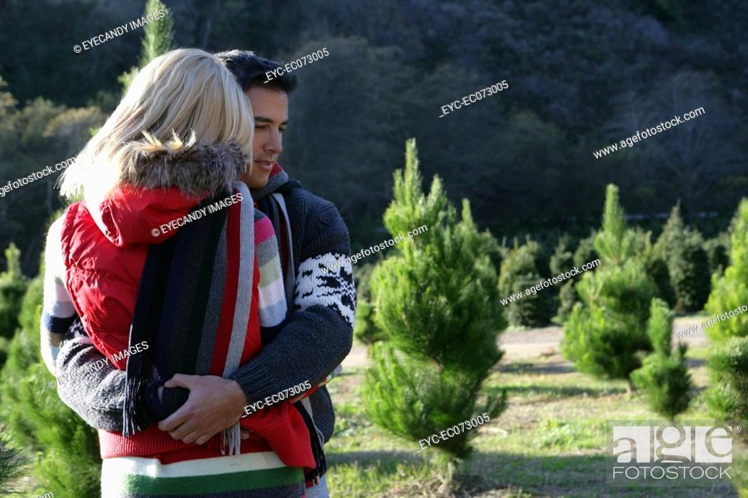 Stock Photo: Young couple hugging outdoors in winter.