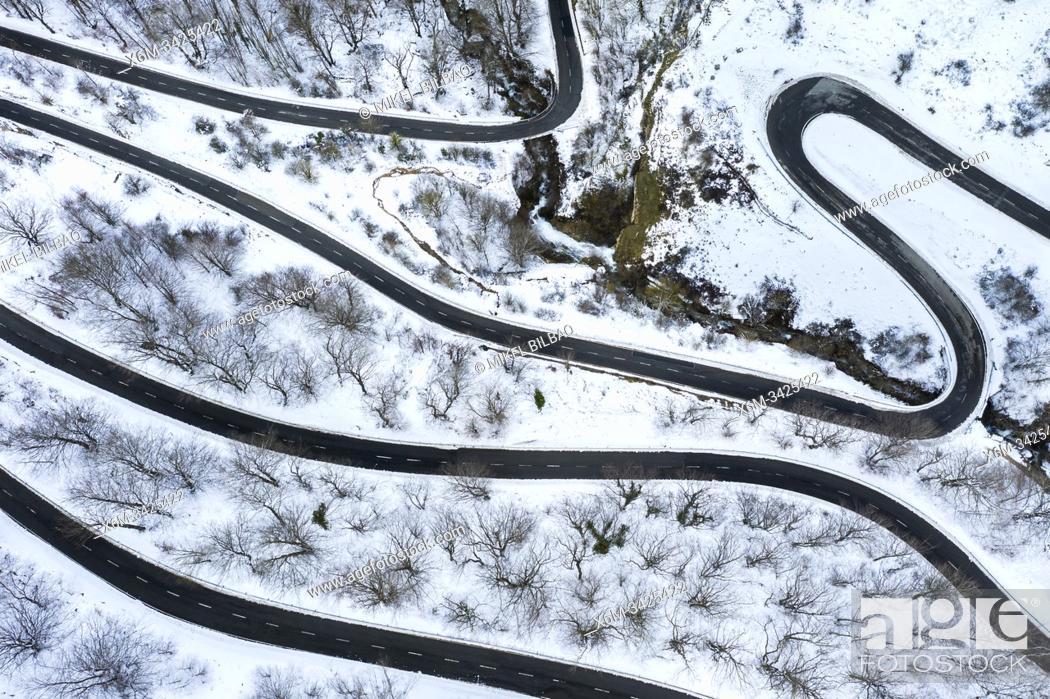Stock Photo: Snow-covered road. Olazagutia pass. Urbasa mountain range. Navarre, Spain, Europe.
