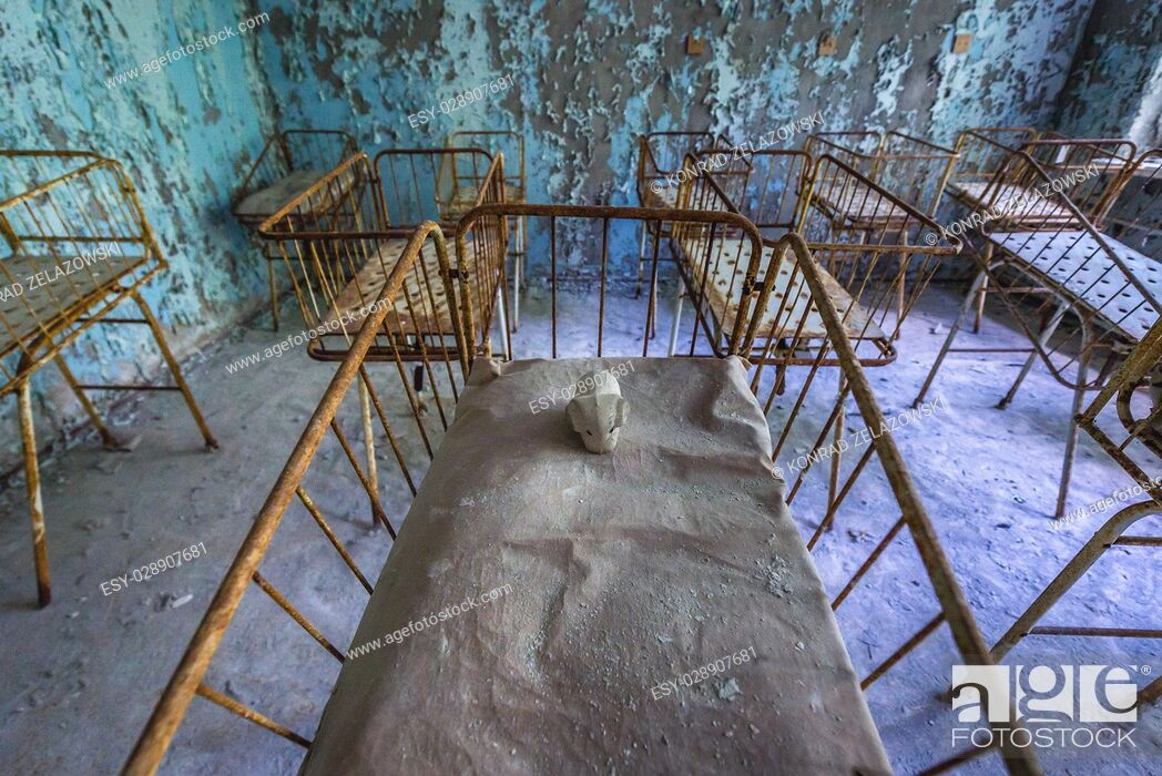 Stock Photo: Infant cribs in Hospital No. 126 of Pripyat ghost city, Chernobyl Nuclear Power Plant Zone of Alienation around nuclear reactor disaster, Ukraine.