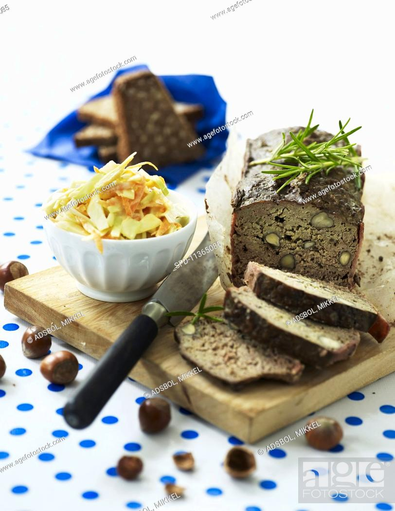 Stock Photo: Meat loaf with hazelnuts and a vegetable and apple salad.
