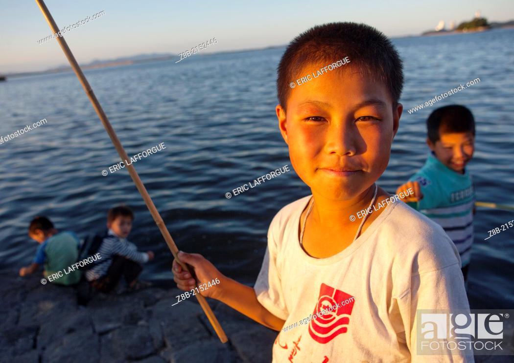 Stock Photo: Kids Fishing, Wonsan, North Korea.