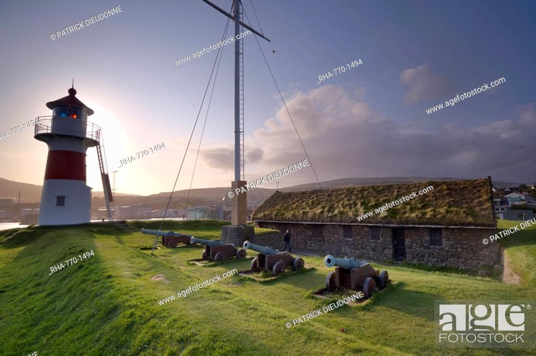Stock Photo: Skansin fort, old fort guarding Torshavn and its harbour old brass cannons, WW2 british marine guns and lighthouse, Nolsoy in the distance, Torshavn, Streymoy.