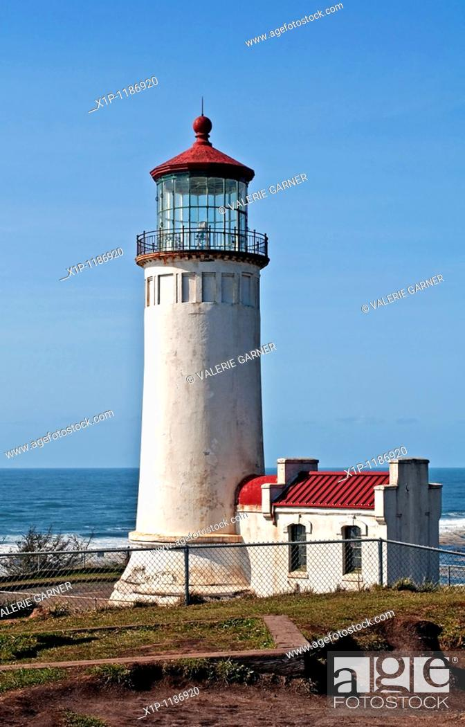 Stock Photo: This is the North Head lighthouse off the Pacific ocean in Washington state in Pacific County, with a bright clear blue sky Beautiful lantern room is at the top.