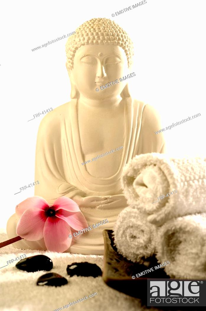 Stock Photo: Buddha with viola and hematite.