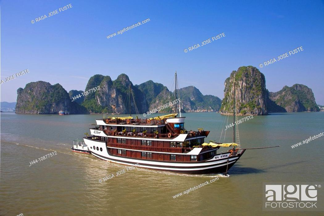 Stock Photo: Vietnam, Asia, Far East, Halong bay, cliff formation, rock, cliff, coast, boat, ship, traveling, place of interest, landmark.