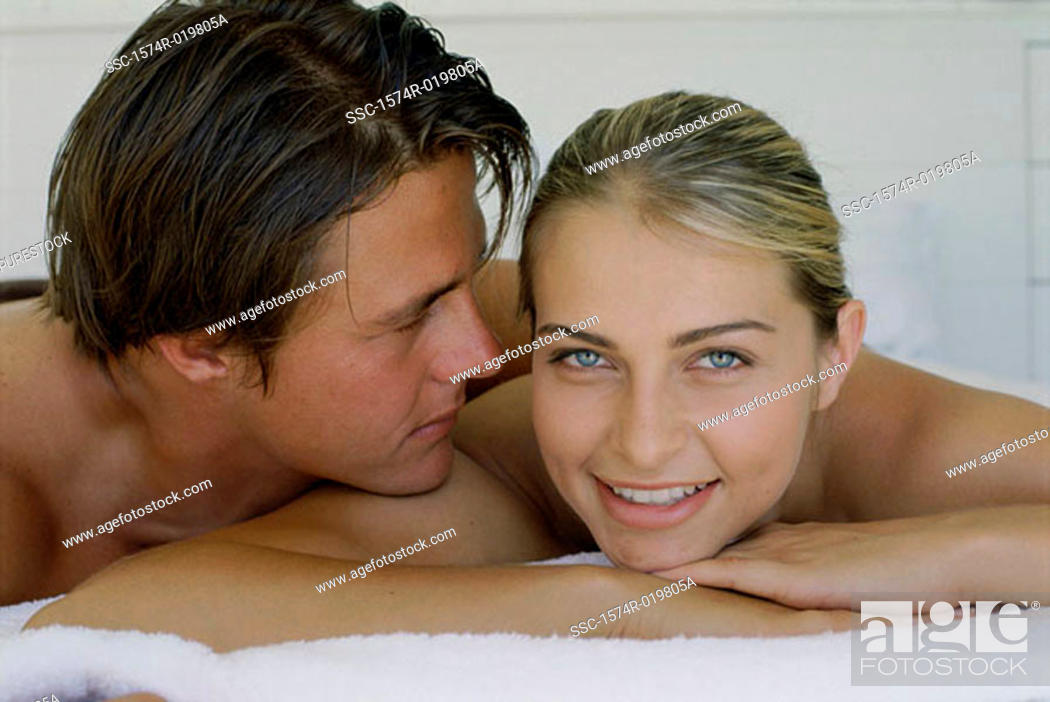 Stock Photo: Portrait of a young couple lying on the bed.