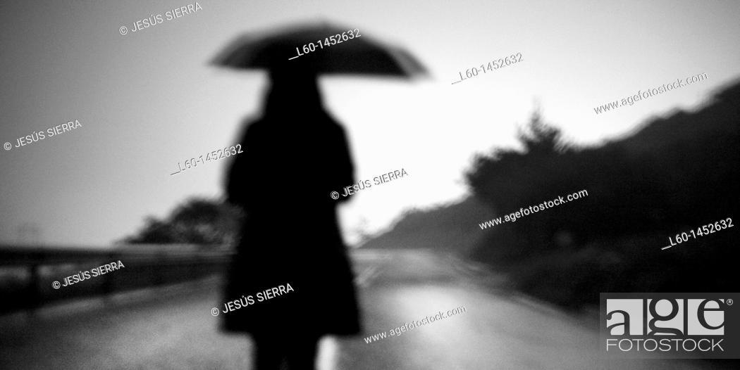 Stock Photo: Girl with umbrella, Viscaya, Spain.