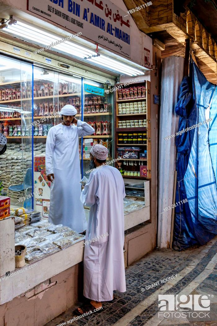Two Omani Men Chatting In The Muttrah Souk (Al Dhalam), Muttrah