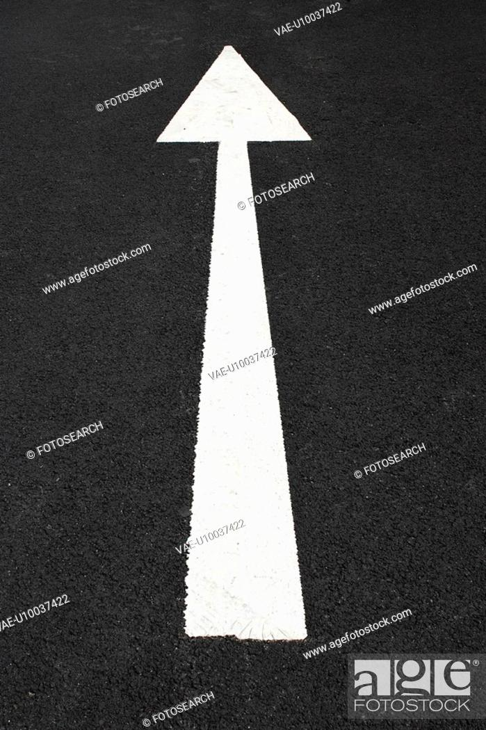 Stock Photo: White arrow on tarmac.