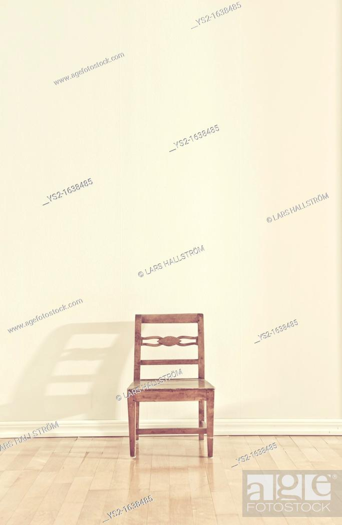 Stock Photo: Empty chair in an empty room.