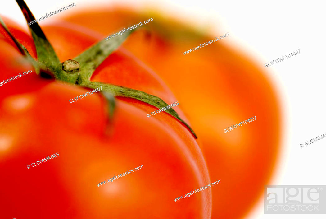 Stock Photo: Close-up of two tomatoes.