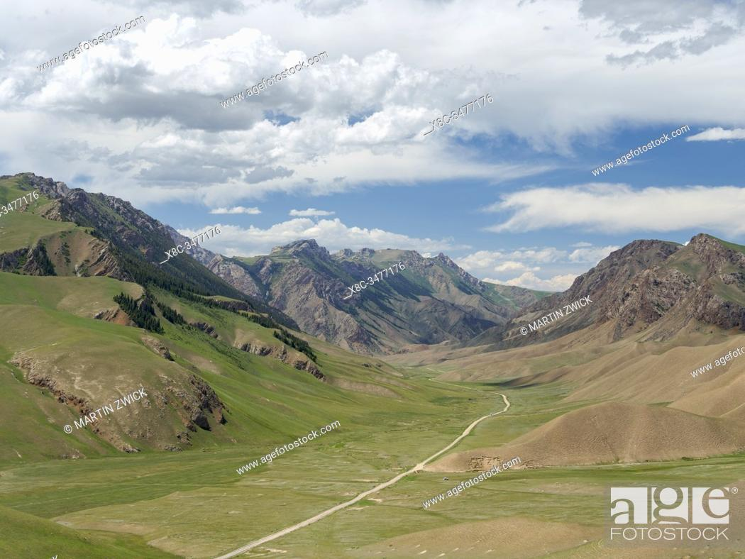 Stock Photo: Along the track leading up to mountain pass Terkey-Torpok . Landscape at lake Song Kol (Son Kul, Songkoel, Song-Koel). Tien Shan mountains or heavenly mountains.