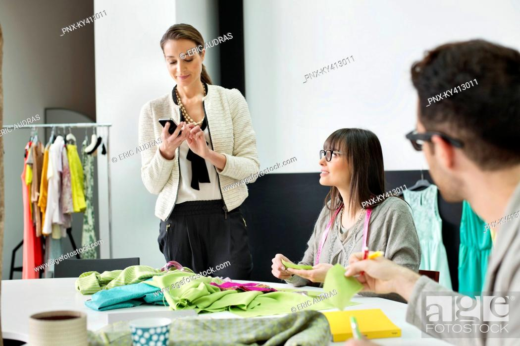 Stock Photo: Fashion designers working in an office.