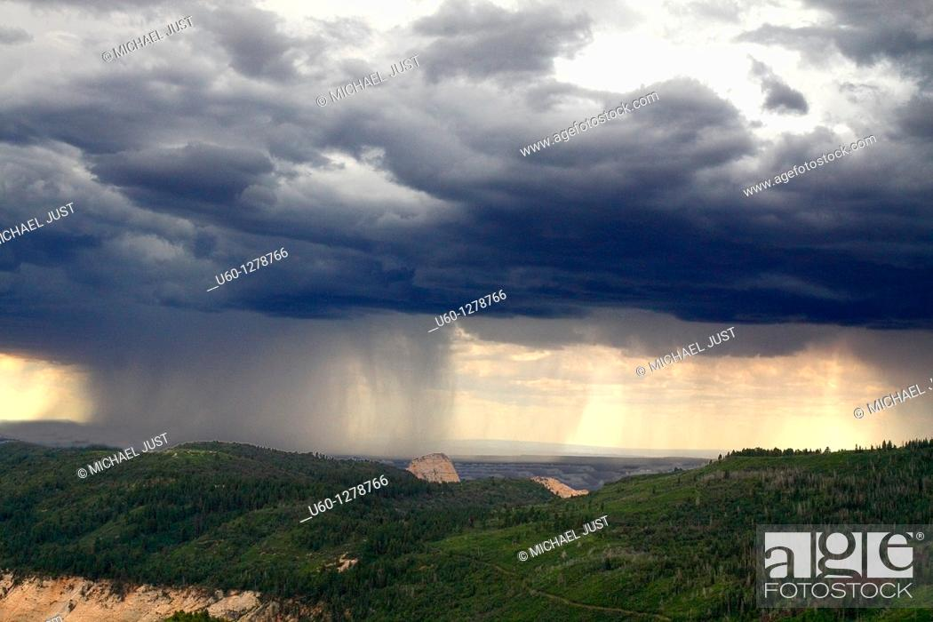 Stock Photo: A fast moving thunderstorm approaches Zion National Park, Utah.
