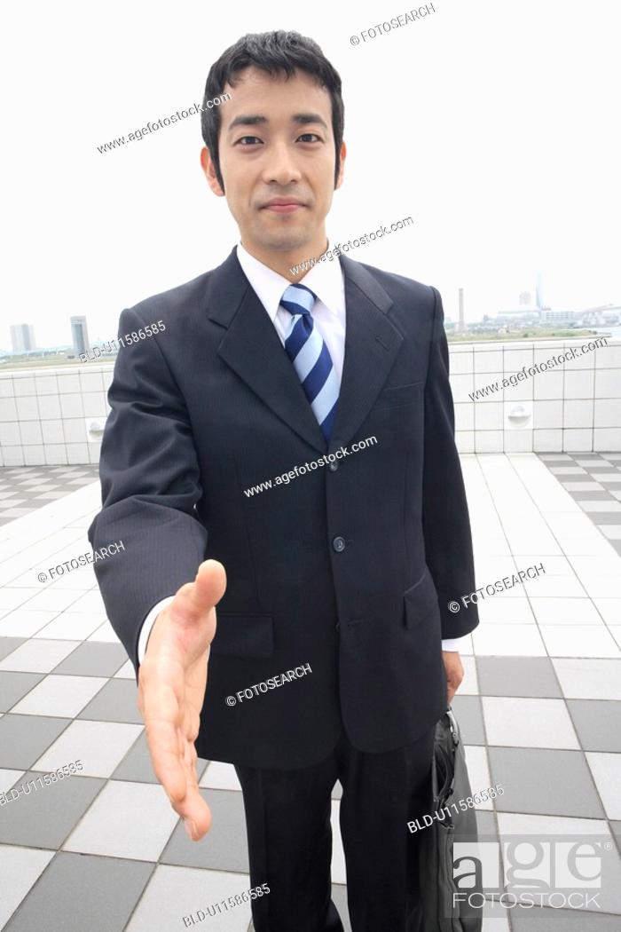 Stock Photo: Businessman trying to shake hands.