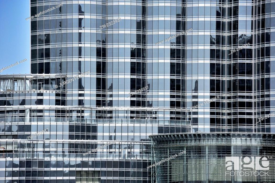 Building of steel and glass, section with the entrance of Burj