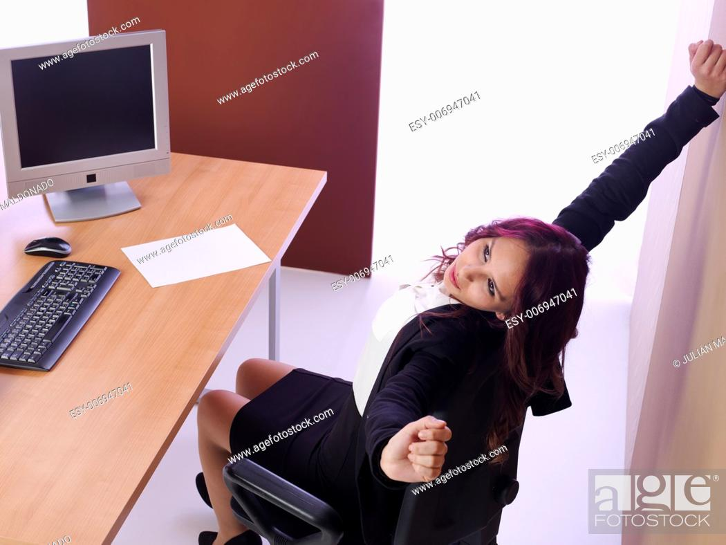 Stock Photo: Women at work with gestures of exhaustion.