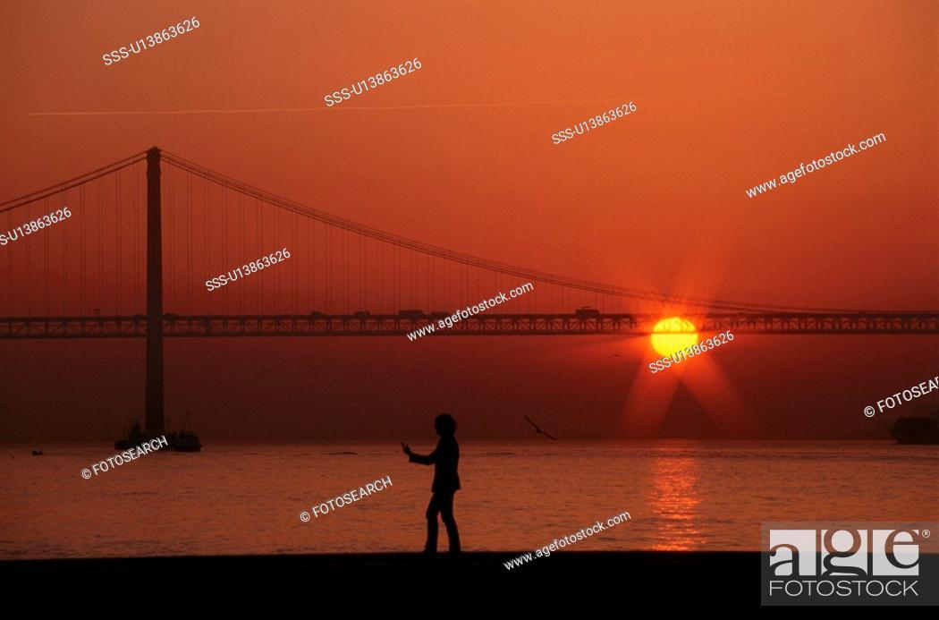 Stock Photo: Walking By Bridge At Sunset.
