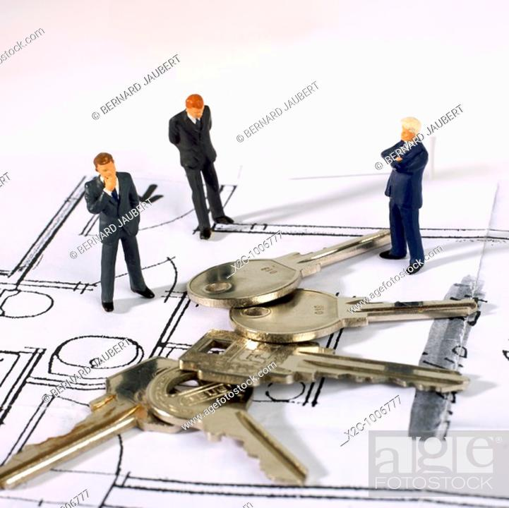 Stock Photo: Architects and plan of buildings.