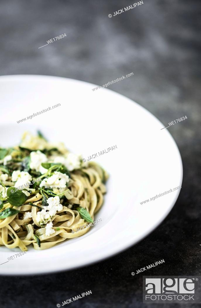 Stock Photo: gourmet organic italian ricotta and fresh mixed herbs tagliatelle on plate.