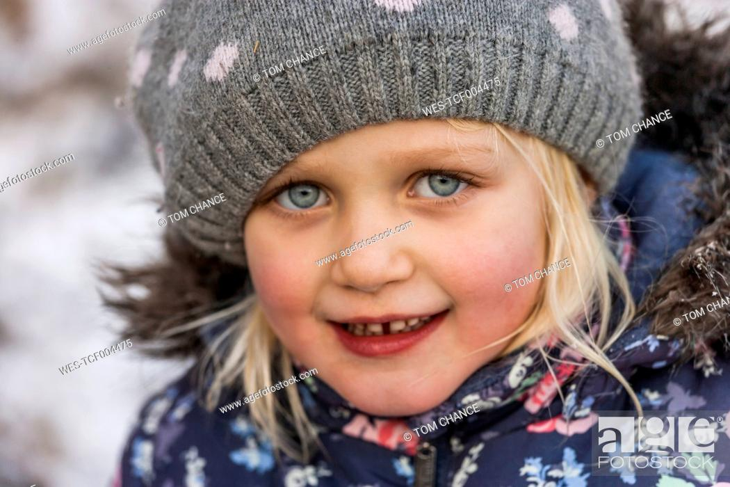 Stock Photo: Portrait of little girl wearing wool cap and winter jacket.