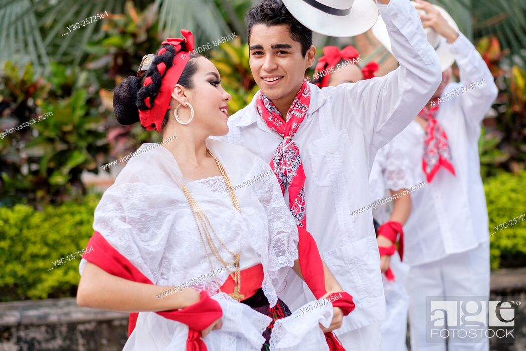 Stock Photo: Young people in folkloristic costumes - Puerto Vallarta, Jalisco, Mexico. Xiutla Dancers - a folkloristic Mexican dance group in traditional costumes.