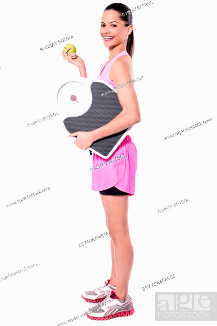 Stock Photo: Side pose of lady holding weighing scale.
