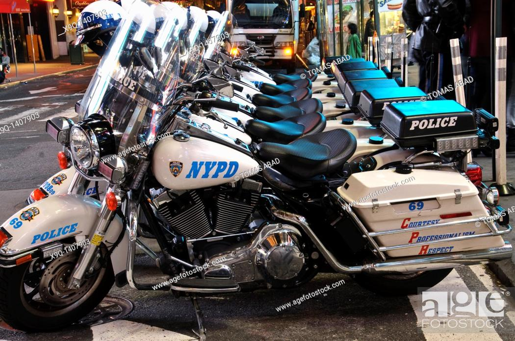 Stock Photo: New York Police Department's Harley-Davidson Electra Glide motorcycles parked in Times Square, 42nd Street, Theater District.