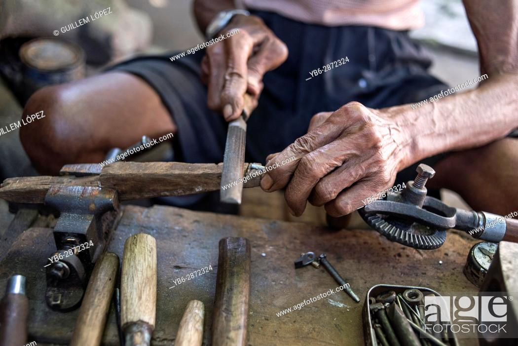 Stock Photo: Senior Carpenter at work in his workshop in Yogyakarta, Java, Indonesia.