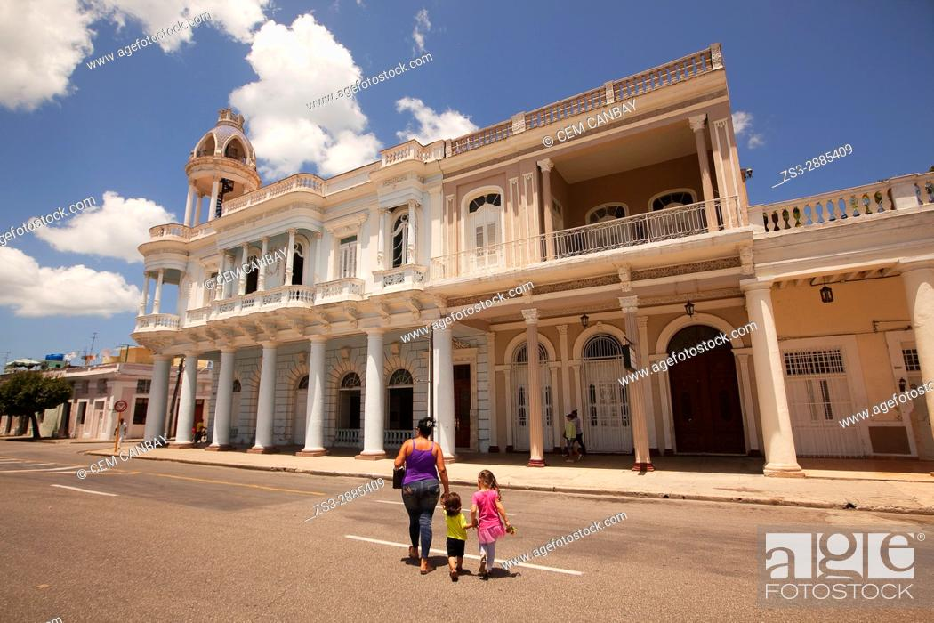 Stock Photo: Mother and children walking in front of the Ferrer Palace-Palacio Ferrer in Plaza de Armas Square, Cienfuegos, Cuba, West Indies, Central America.