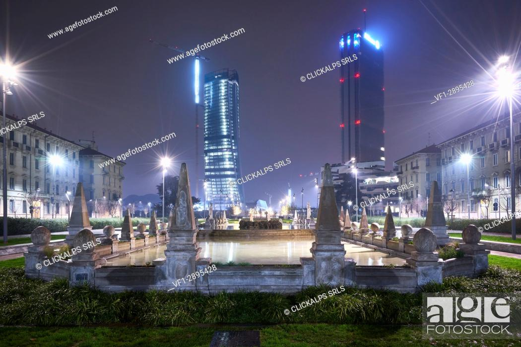 Stock Photo: Milan, Lombardy, Italy. Citylife neighborhood with Fontana delle Quattro Stagioni by night.