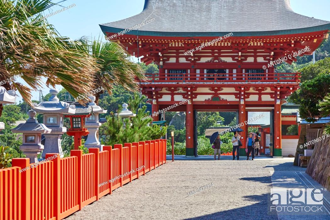 Stock Photo: Three senior japanese woman at the entrance of Udo-Jingu shinto temple. The shrine is dedicated to Yamasachihiko, the father of Jimmu.