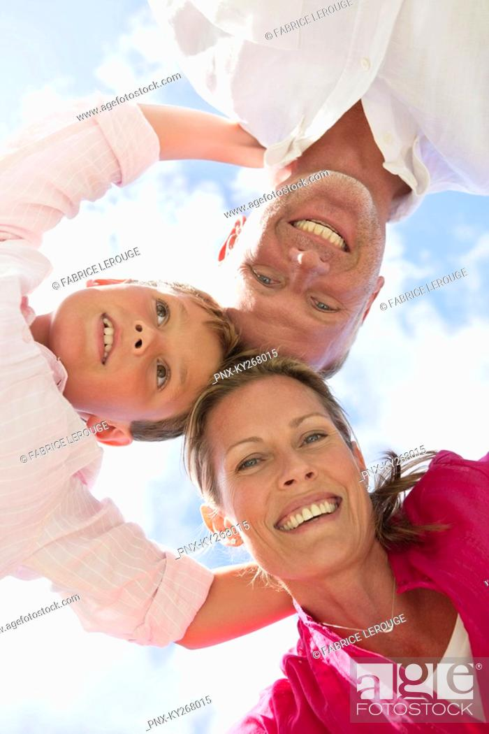Stock Photo: Low angle view of a family in huddle.