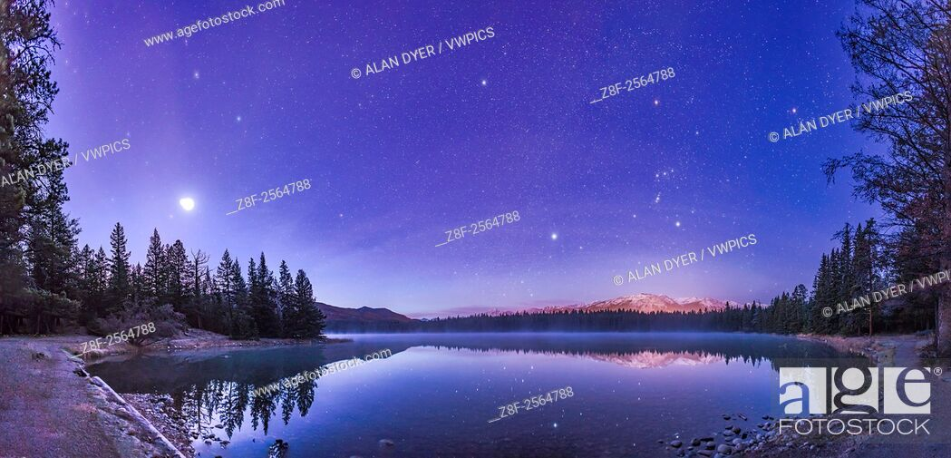 Stock Photo: A panorama of roughly 120° showing a star- and planet-filled sky in the dawn twilight over Lake Annette in Jasper National Park, Alberta.
