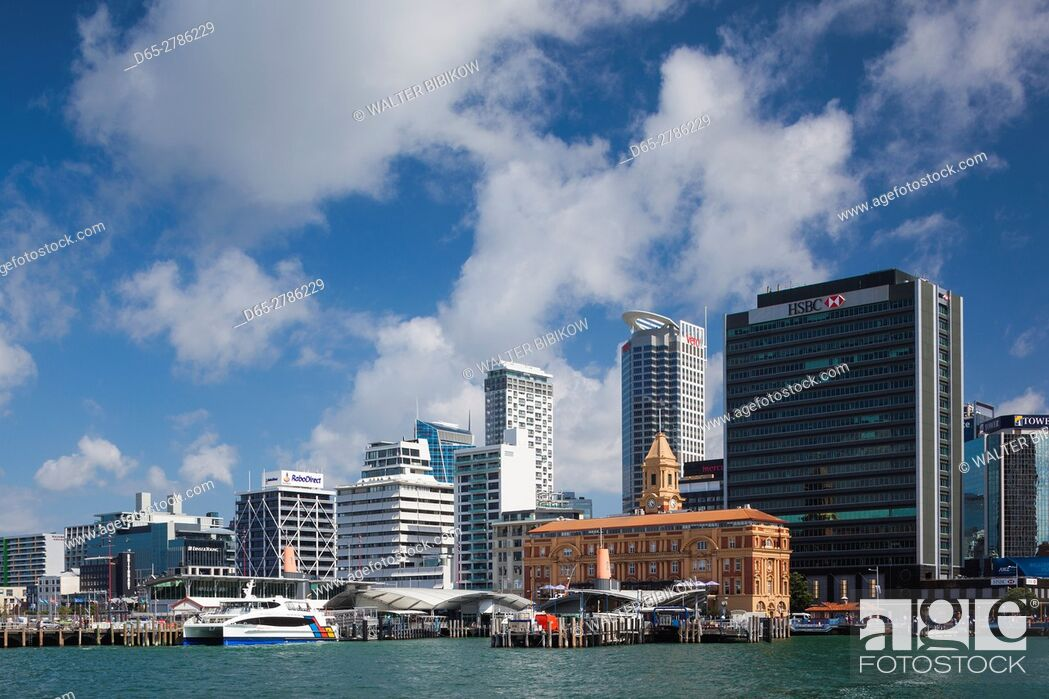 Stock Photo: New Zealand, North Island, Auckland, harbor view skyline with Ferry Building.