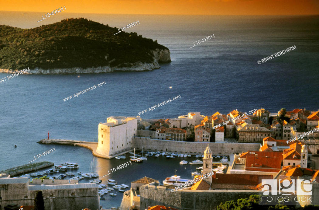 Stock Photo: Early morning over old town Dubrovnick and old harbor, Lokrum Island in Adriatic Sea. Croatia.