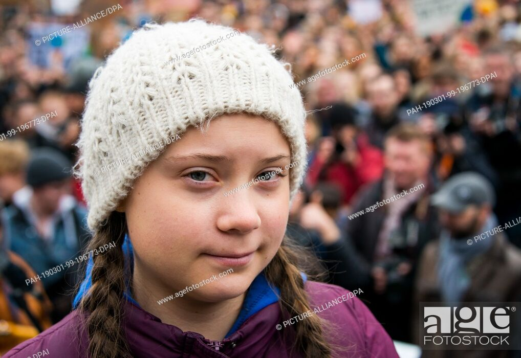Stock Photo: 01 March 2019, Hamburg: Greta Thunberg, climate activist, stands before a rally on the Rathausmarkt in front of the Rathaus.