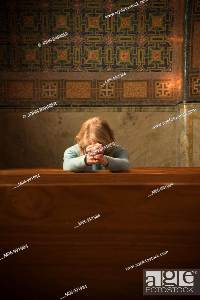Stock Photo: Woman Praying in Church.