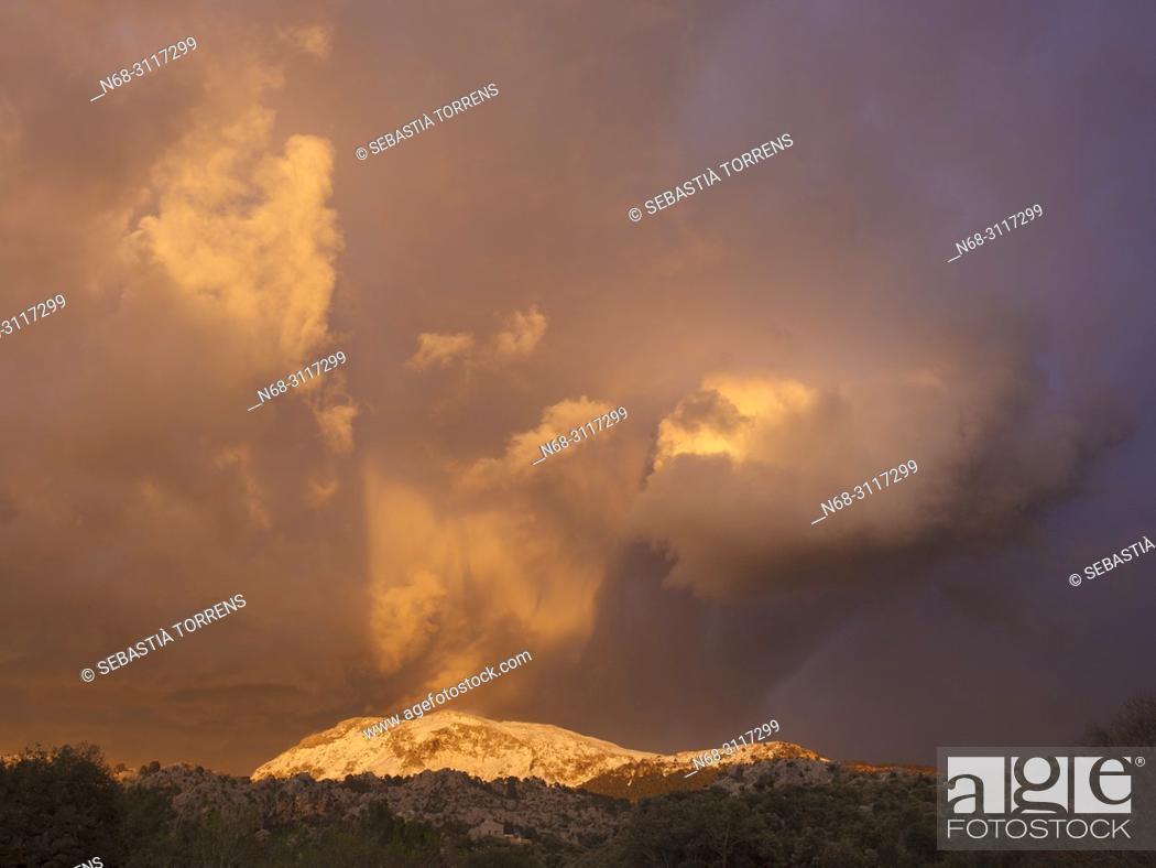 Stock Photo: Clouds over Puig Tomir at sunset, Serra de Tramuntana, Escorca, Majorca, Balearic Islands, Spain.