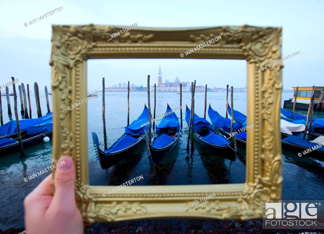 Stock Photo: Grand Canal and gondolas at dawn framed within ornate picture frame in Venice Italy.