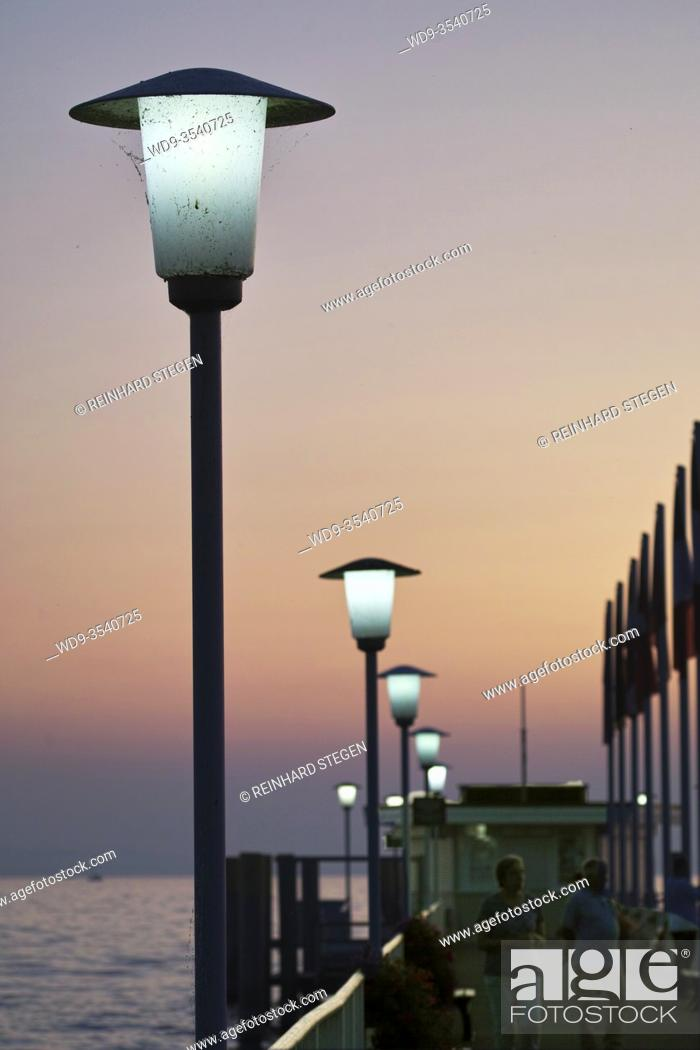Imagen: enlighted pier, lake Constance, sunset mood, atmosphere, between day and night, evening.