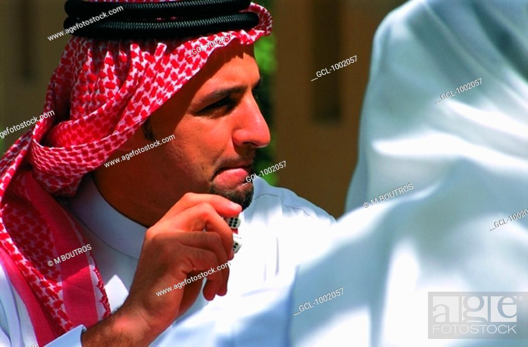 Stock Photo: Arab men enjoying a game of backgammon.