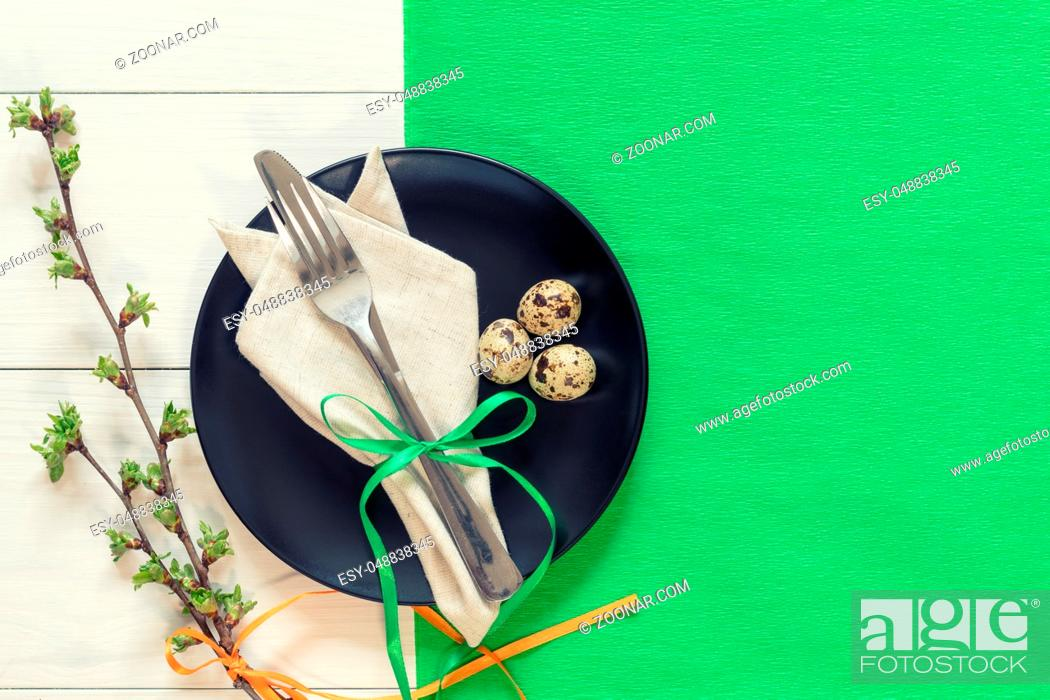 Stock Photo: Easter table setting with spring flowers and cutlery. Rustic green table cloth on white wood background. Holidays background with copy space.