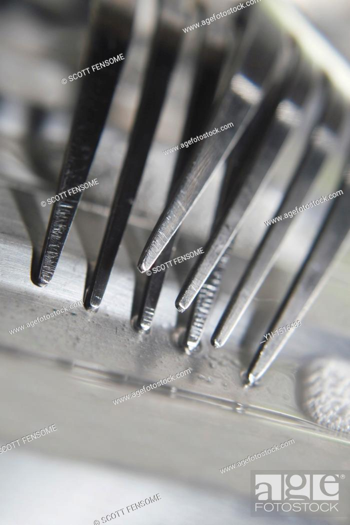 Stock Photo: close up of forks on draining board.