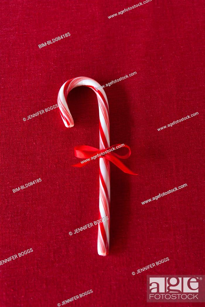 Photo de stock: Candy cane with red bow.